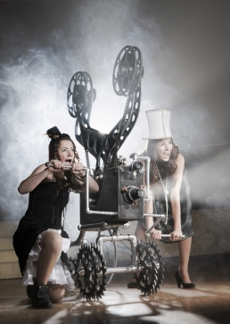 Two cute young girls with a film projector